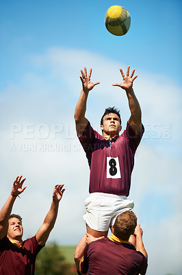 Buy stock photo Shot of a young rugby player catching the ball during a lineout