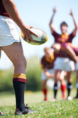 Buy stock photo Rearview shot of a young rugby player taking a lineout