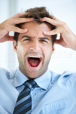 Buy stock photo Portrait of a young businessman shouting with fingers clasping his head