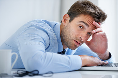 Buy stock photo Portrait of an exhausted businessman falling asleep behind his laptop