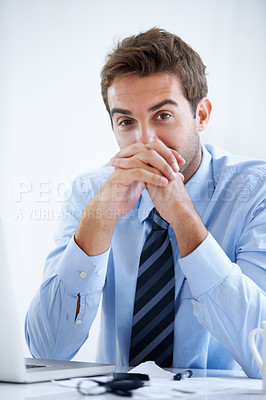 Buy stock photo Portrait of a business man sitting at a desk resting his face against his clasped hands