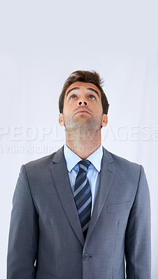 Buy stock photo A businessman standing and looking up with copyspace