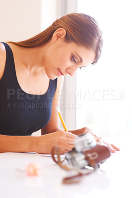 Buy stock photo Cropped view of a woman writing a letter