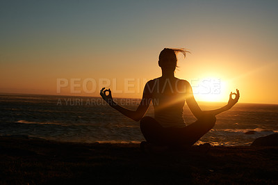 Buy stock photo Silhouette of a woman doing a yoga pose against a setting sun
