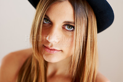 Buy stock photo Portrait of a gorgeous young woman wearing a hat