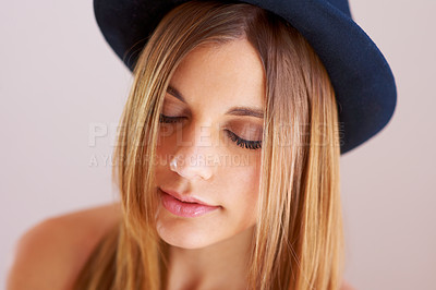 Buy stock photo A gorgeous young woman wearing a hat with eyes closed