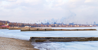 Buy stock photo Shot of air pollution over an industrial area