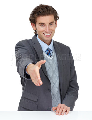 Buy stock photo A smiling businessman offering you a handshake to seal an agreement
