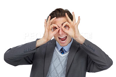 Buy stock photo Playful image of an excited businessman pretending his hands are glasses - isolated