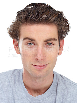 Buy stock photo Young man looking straight at the camera with a faint smile