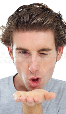 Buy stock photo Handsome young man winking and blowing a kiss