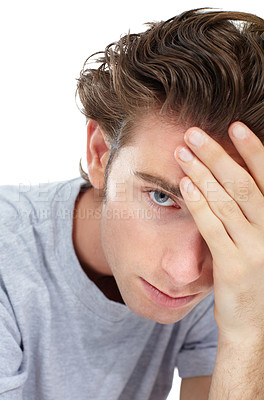Buy stock photo Disheartened young man looking at the camera with his hand on his forehead