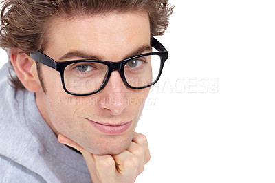 Buy stock photo Handsome young man posing with his chin resting on his hand