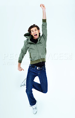 Buy stock photo Portrait of a young man cheering in victory