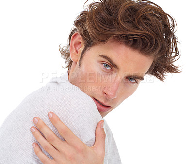 Buy stock photo Handsome young man posing with his hand on his shoulder