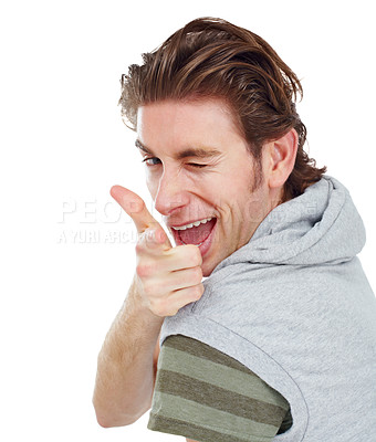 Buy stock photo Handsome young man winking and pointing over his shoulder