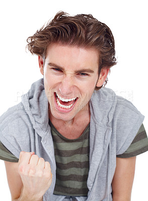 Buy stock photo Young man doing a fist pump in an expression of victory