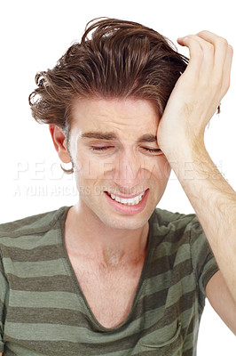 Buy stock photo Drowsy young man wiping his eye with his palm