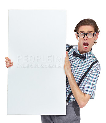 Buy stock photo Portrait of a young man looking shocked by the unbelievable sign he's holding