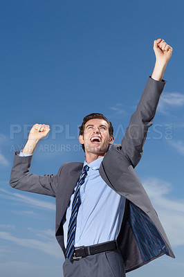 Buy stock photo A successful businessman celebrating an approved contract