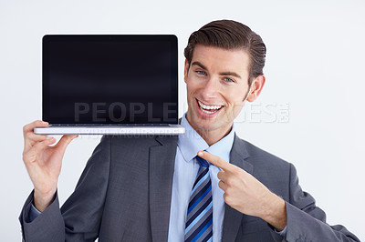 Buy stock photo A young businessman pointing at a laptop enthusiastically