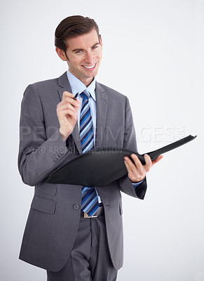 Buy stock photo A pleased business manager holding his notepad and pointing at you with his pen