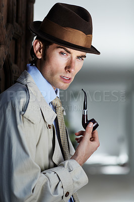 Buy stock photo Thoughtful private investigator smoking his pipe