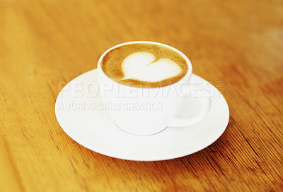 Buy stock photo High angle shot of a lovingly prepared cup of cappuccino sitting on a cafe table