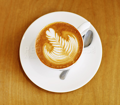 Buy stock photo High angle shot of an artistically prepared cup of cappuccino