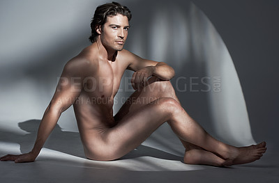Buy stock photo Studio shot of a handsome young nude man