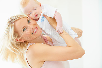 Buy stock photo A lovely mother lifting her adorable baby girl