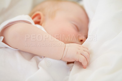 Buy stock photo A baby girl fast asleep in between her white pillows
