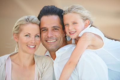 Buy stock photo Two delighted parents spending time with their adorable daughter