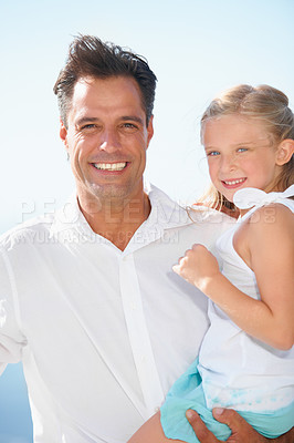 Buy stock photo A happy father carrying his adorable daughter as they enjoy a day in the sun