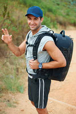 Buy stock photo Handsome young hiker waving at the camera - portrait