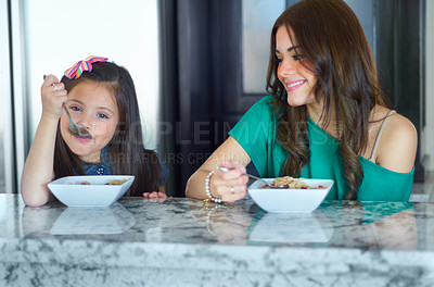 Buy stock photo Mother and daughter enjoying breakfast together before school