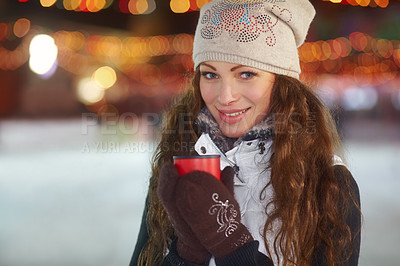 Buy stock photo A beautiful young woman standing outdoors enjoying a hot beverage