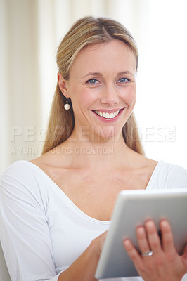 Buy stock photo Portrait of an attractive young woman sitting at home with her digital tablet