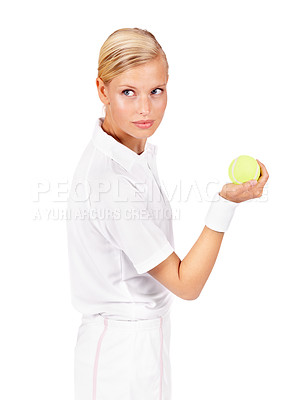 Buy stock photo An attractive young woman holding a tennis ball and looking at her opponent
