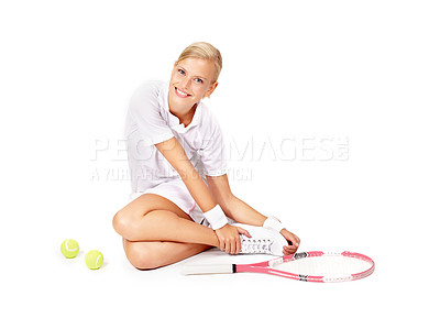 Buy stock photo Portrait of an attractive young woman sitting on the floor with her tennis equipment