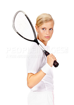Buy stock photo A confident looking woman holding her squash racquet