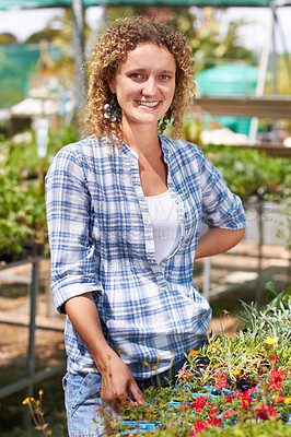 Buy stock photo Shot of a woman looking around a garden center