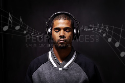 Buy stock photo Digitally enhanced image of young man listening to music as it travels from his head phones