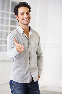 Buy stock photo Portrait of handsome male with his arm outstretched in greeting