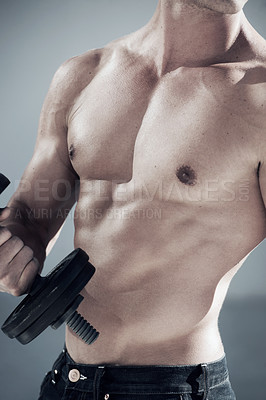 Buy stock photo a cropped shot of a muscular male with a bare chest lifting weights
