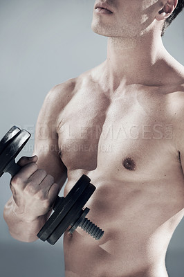 Buy stock photo A close up of a masculine male lifting weights
