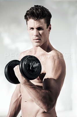 Buy stock photo A masculine male with no shirt on holding weights