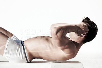 Buy stock photo A side view of muscular male doing sit ups with no top on