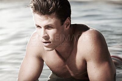 Buy stock photo A good looking male lying in the water