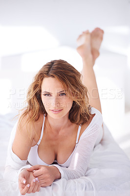 Buy stock photo Portrait of a woman lying on her bed with her bra exposed